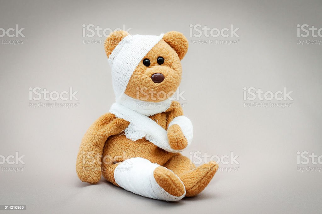 Teddy bear with bandage stock photo