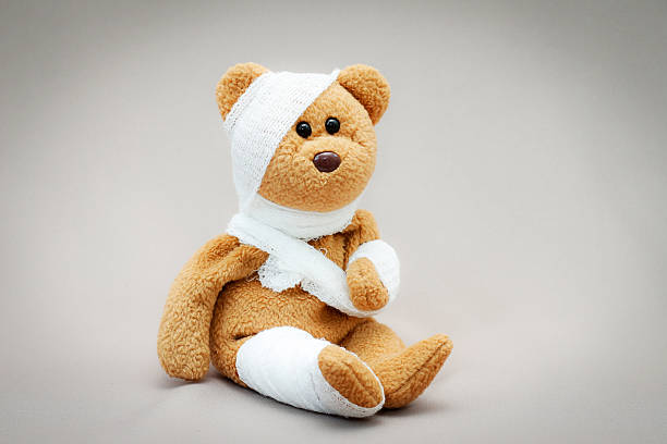 teddy bear with bandage - medical dressing stock pictures, royalty-free photos & images