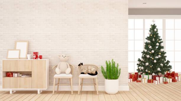 teddybär mit katze auf stuhl und weihnachtsbaum im wohnzimmer oder kind raum - artwork für weihnachten und frohes neues jahr - 3d rendering - katzenschrank stock-fotos und bilder
