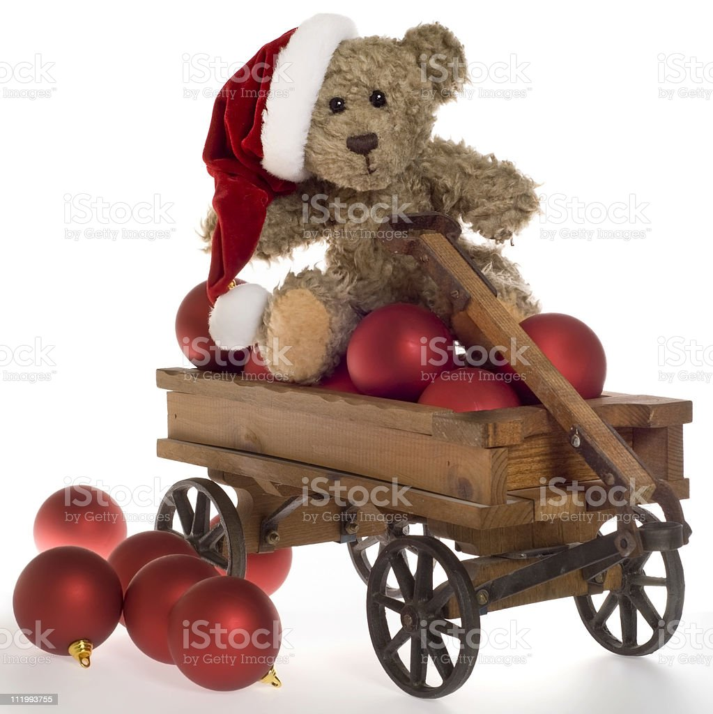 Teddy Bear with Christmas Ornaments in Toy Wagon royalty-free stock photo