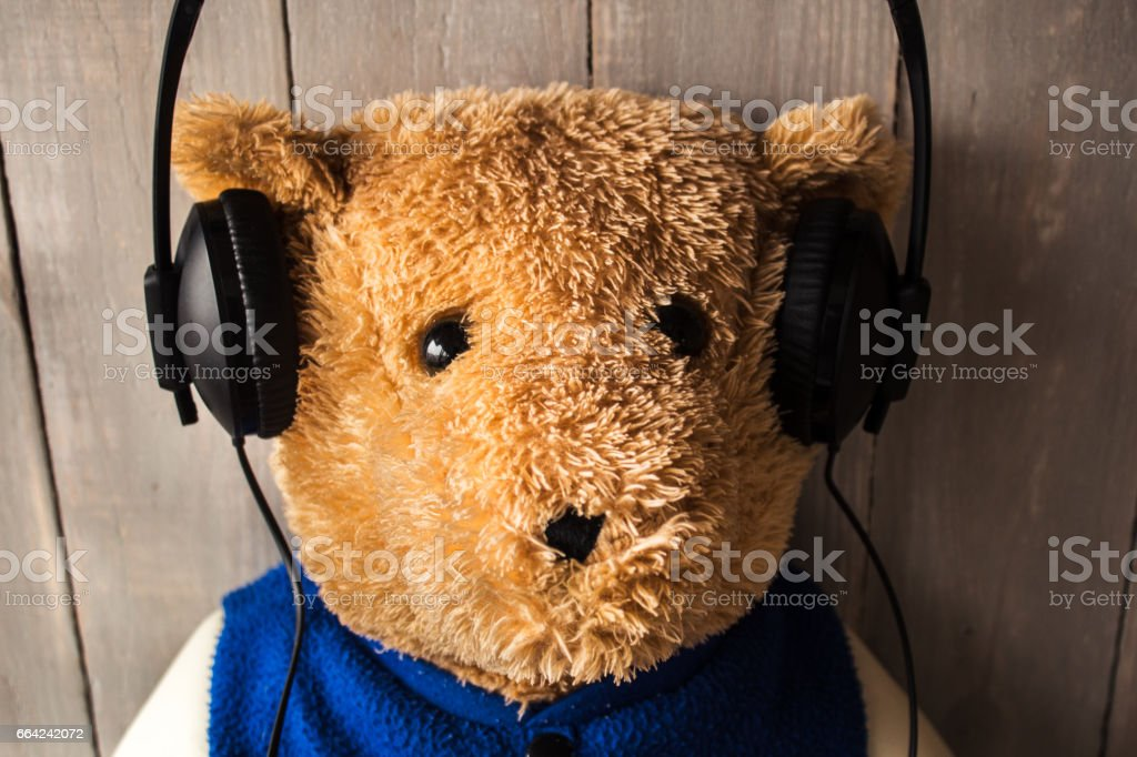 teddy bear with headphones on stock photo