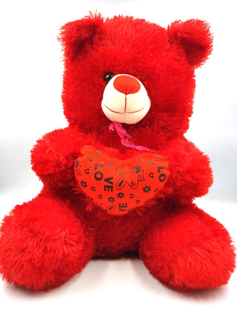 teddy bear with heart shaped pillow teddy bear with heart shaped pillow christmas teddy bear stock pictures, royalty-free photos & images