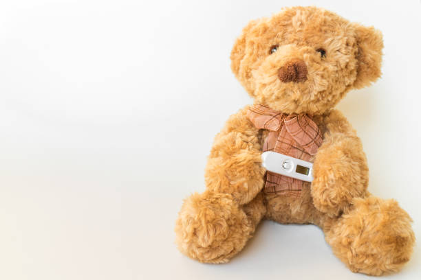 Royalty free temperature measurement with toy bear pictures images teddy bear with thermometer and cold stock photo thecheapjerseys Gallery