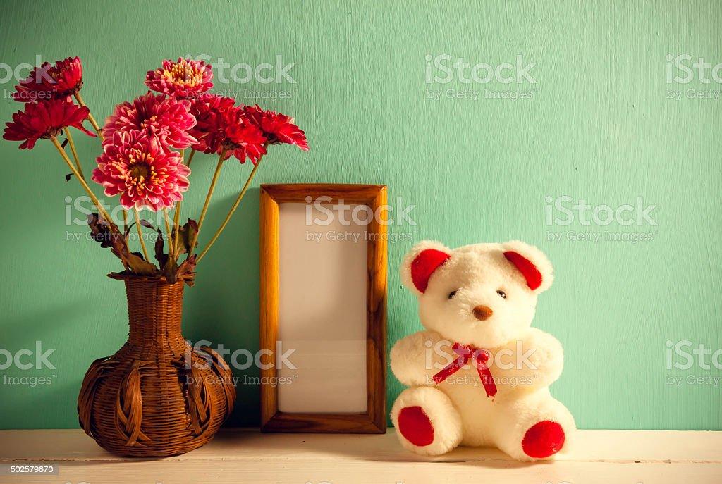 Teddy Bearpicture Frameflower In Vase On Wood Background Stock Photo