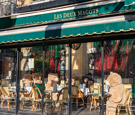 Paris, France - January 09 2021: Customers replaced by Teddy bears in cafe Les Deux Magots during Covid-19 Lockdown