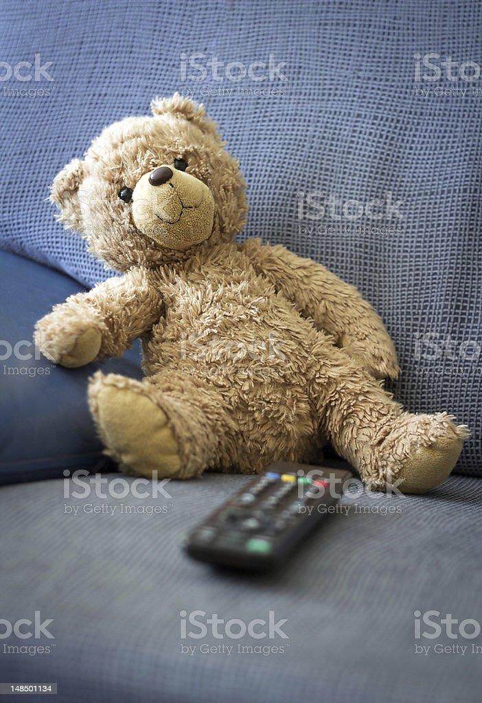 Teddy watching TV stock photo