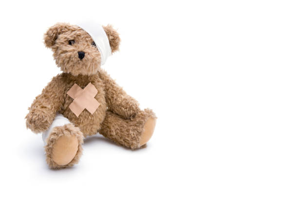 teddy with bandage - teddy bear stock photos and pictures