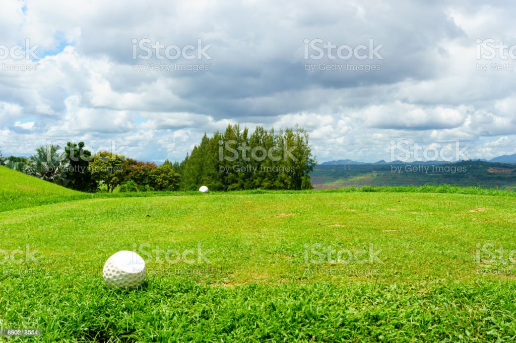 tee off with forest and blue sky and cloud background. stock photo