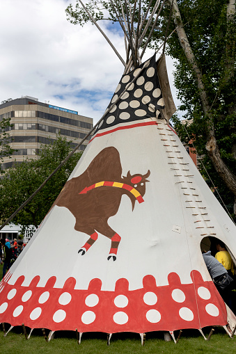 Calgary, Canada - July 9, 2016: View of Tipis in the Indian Village at the Calgary Stampede on July 9, 2016 in Calgary, Alberta. The Indian Village represents First Nations people at the Calgary Stampede.