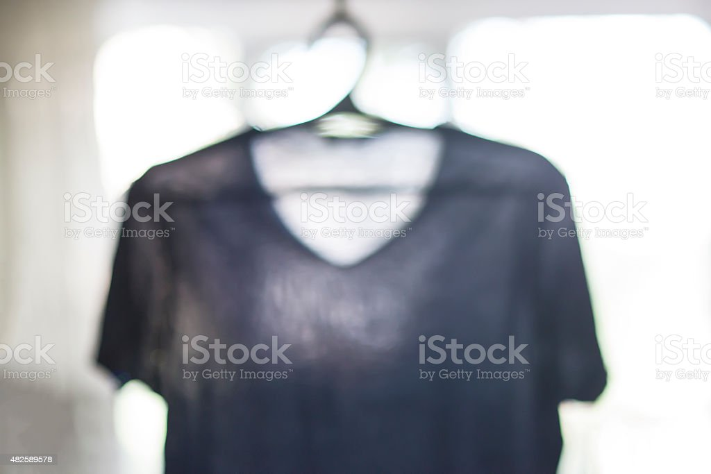 Tee shirt hanger, blur stock photo