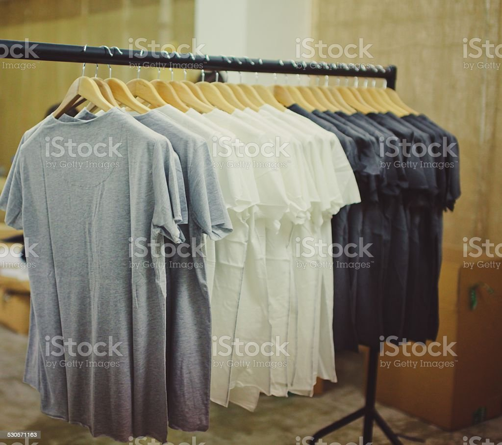 tee shirt rail stock photo