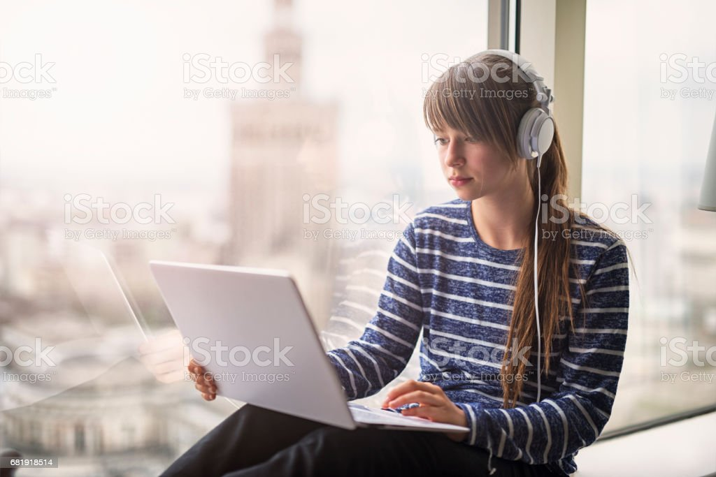 Teeange girl studying in Warsaw. stock photo