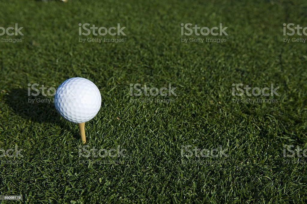 Teeing off a Golf Ball at a Golf Course royalty-free stock photo