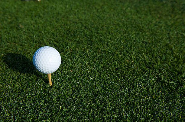 Teeing off a Golf Ball at a Golf Course stock photo