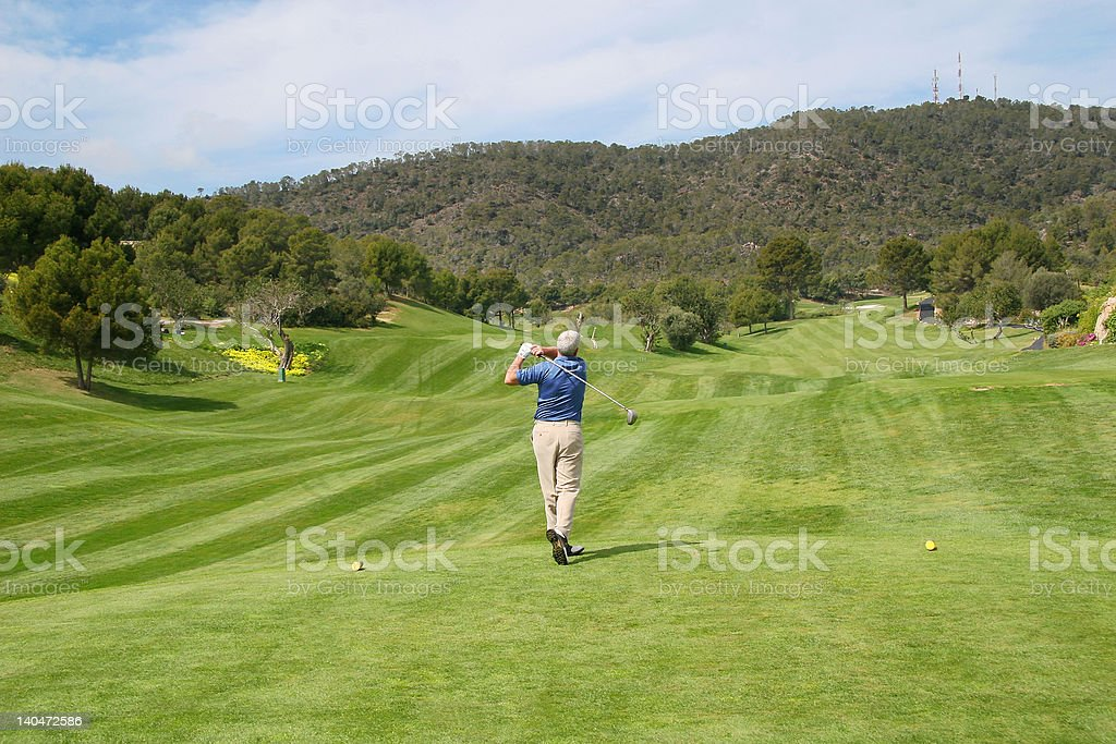 Teeing off on the 5th royalty-free stock photo