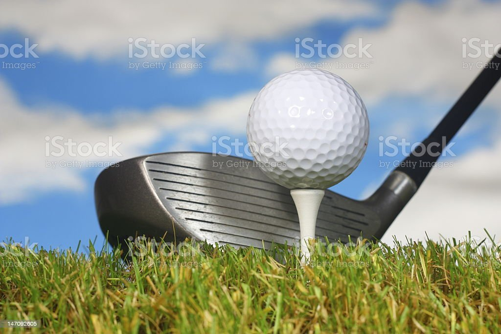 Teeing off with a driver. stock photo