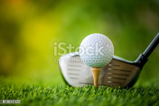 istock teeing off with golf club and golf ball 813012122