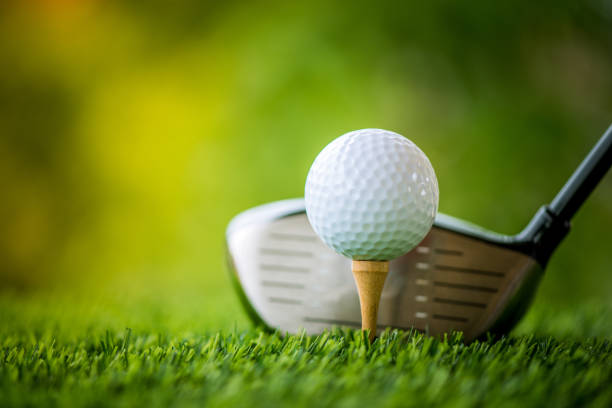 teeing off with golf club and golf ball teeing off with golf club and golf ball golf ball stock pictures, royalty-free photos & images