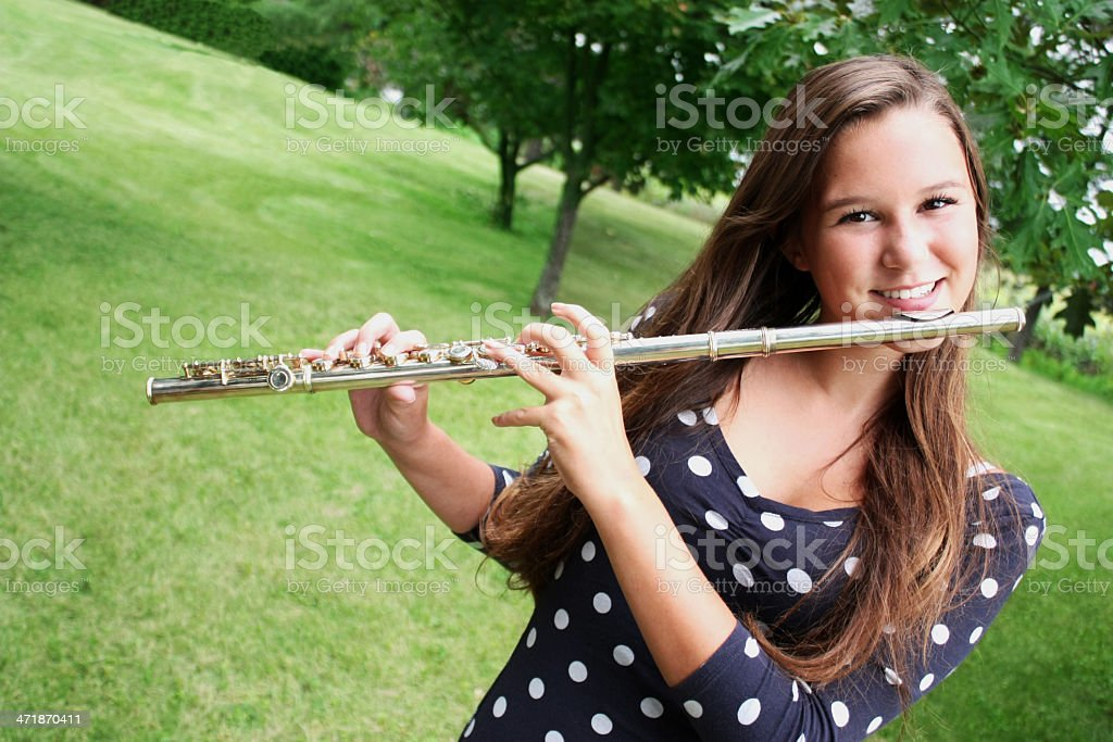 teen Age Girl Playing Traversal Flute Outdoors, Countryside Serene place royalty-free stock photo