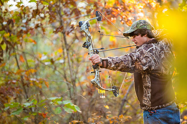 Teen Boy Compound Bow Hunting stock photo