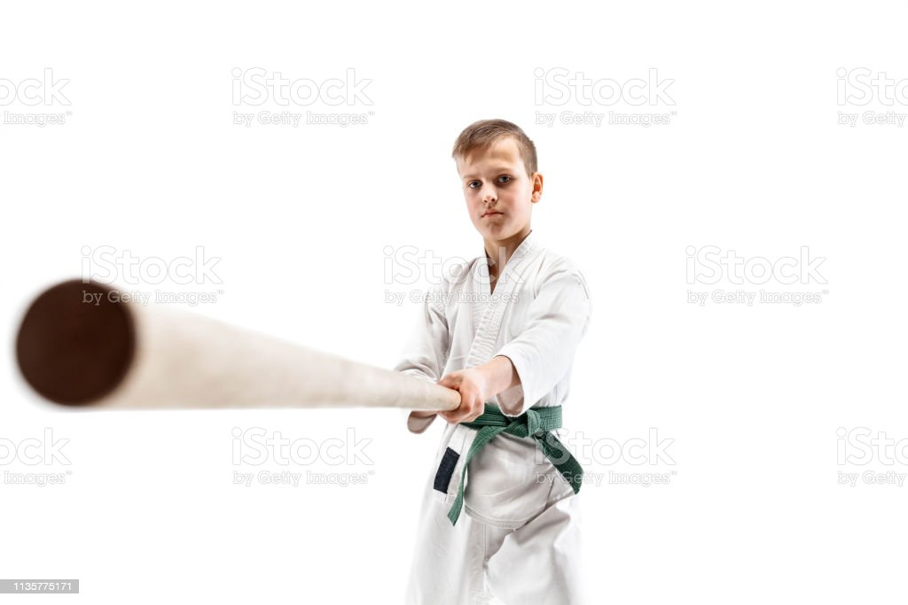Teen Boy Fighting With Wooden Sword At Aikido Training In