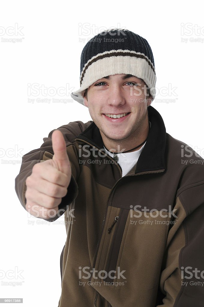 Teen boy giving thumbs up sign royalty-free stock photo