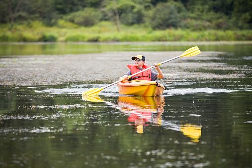 Teen Boy In Kayak Stock Photo - Download Image Now
