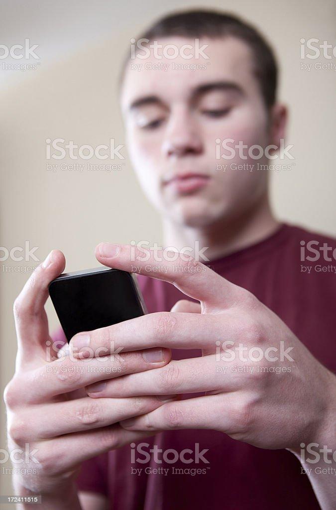 Teen Boy Texting Vertical royalty-free stock photo