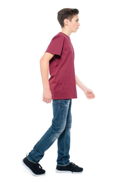 teen boy walking - posing at studio stock photo
