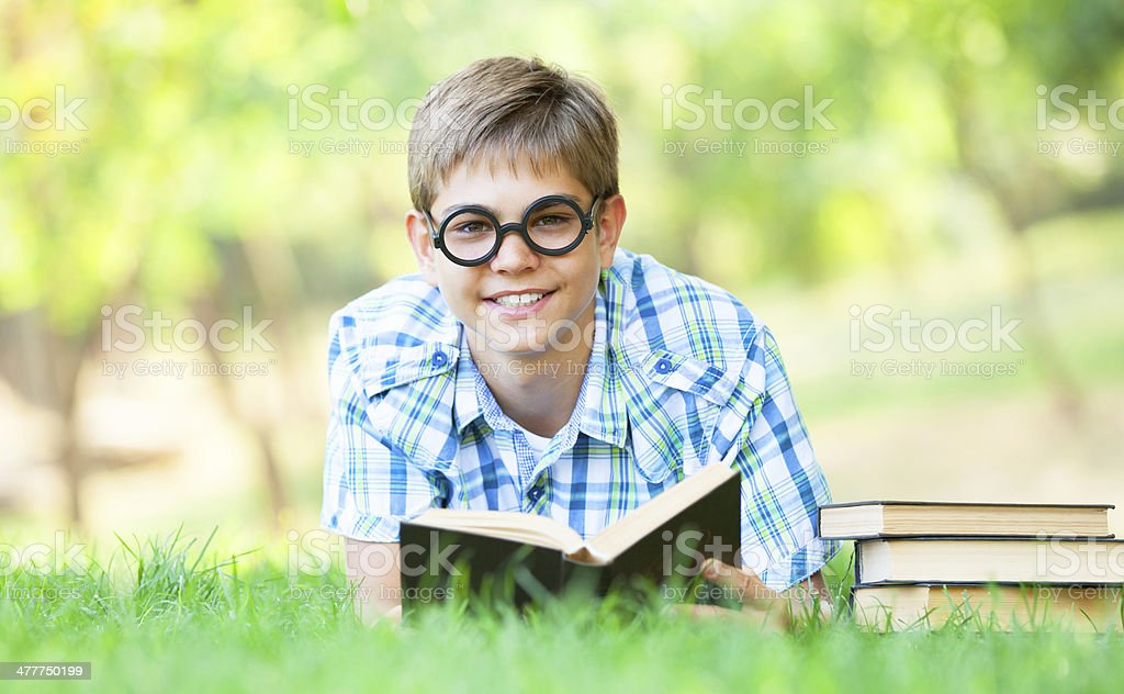 Teen boy with books in the park. royalty-free stock photo