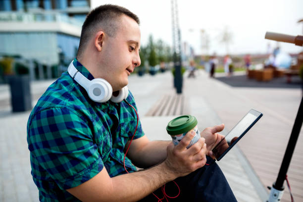 Teen boy with Down syndrome on the way to school stock photo