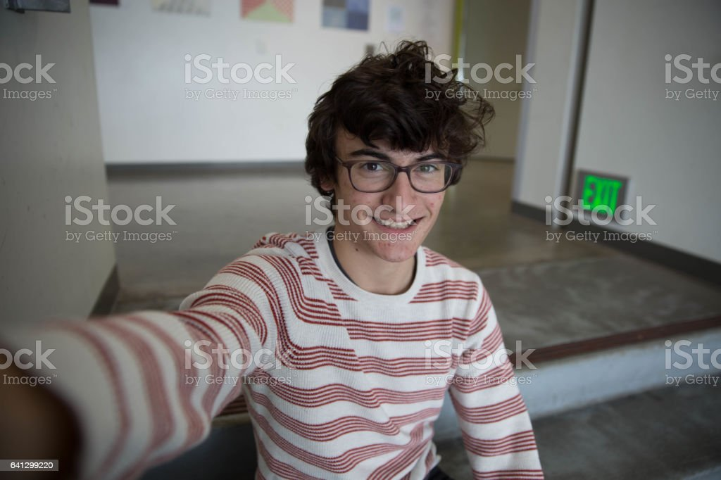Teen Boy With Glasses Taking Selfie Smiling stock photo