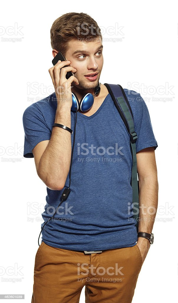 Teen boy with smart phone Portrait of teen boy talking on phone. Studio shot, white background. 18-19 Years Stock Photo