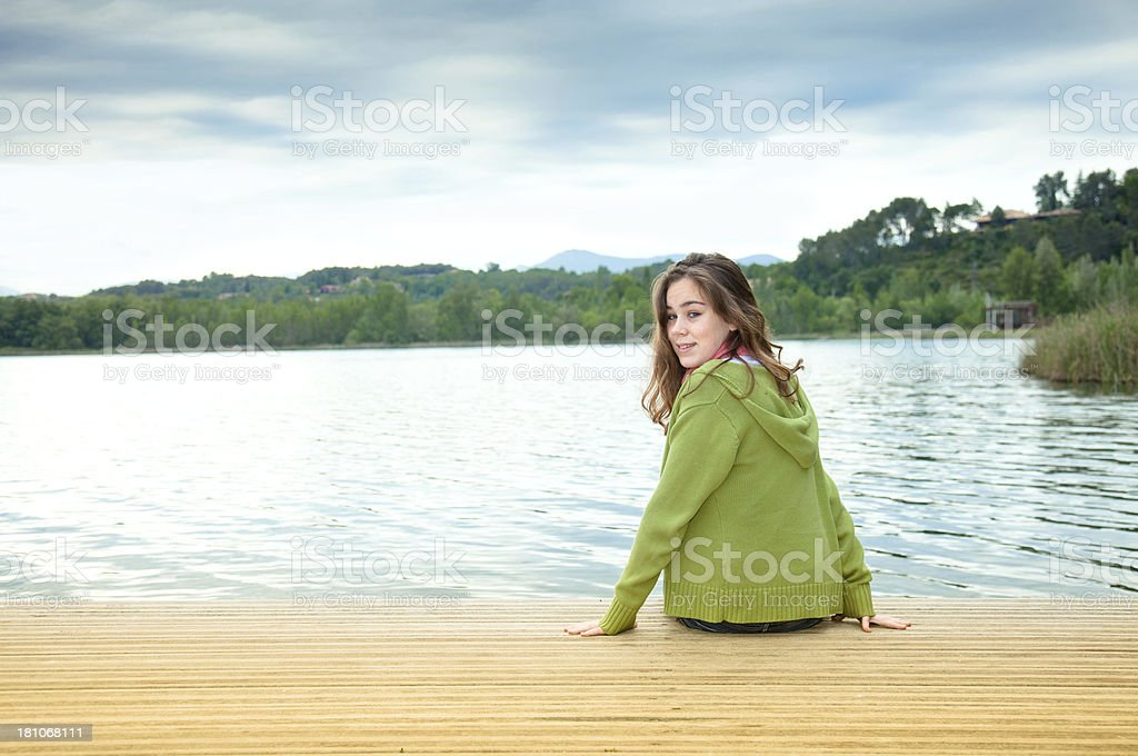 Teen by a lake stock photo