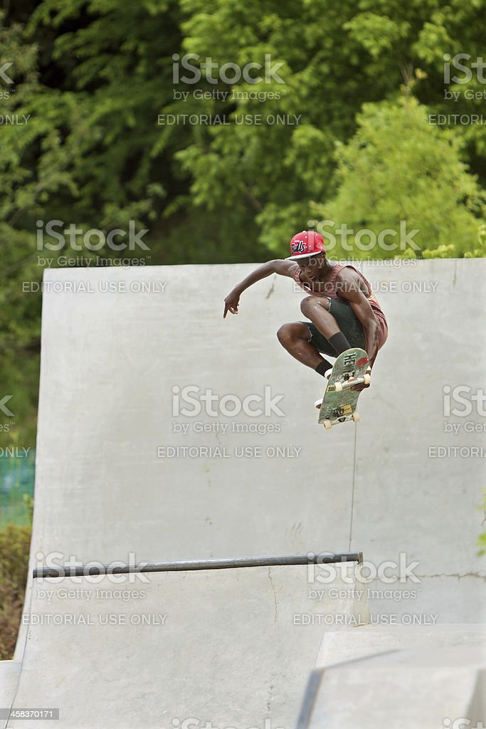 Teen Catches Big Air Skateboarding Off Concrete Ramp royalty-free stock photo