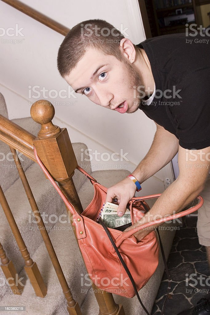 Teen caught stealing money stock photo