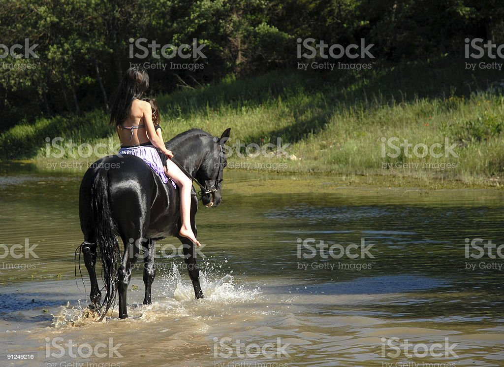 teen, child and horse in river royalty-free stock photo