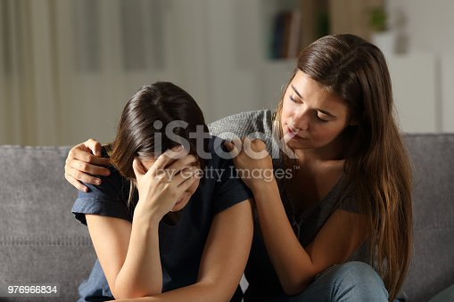 istock Teen comforting hes sad friend in the night 976966834