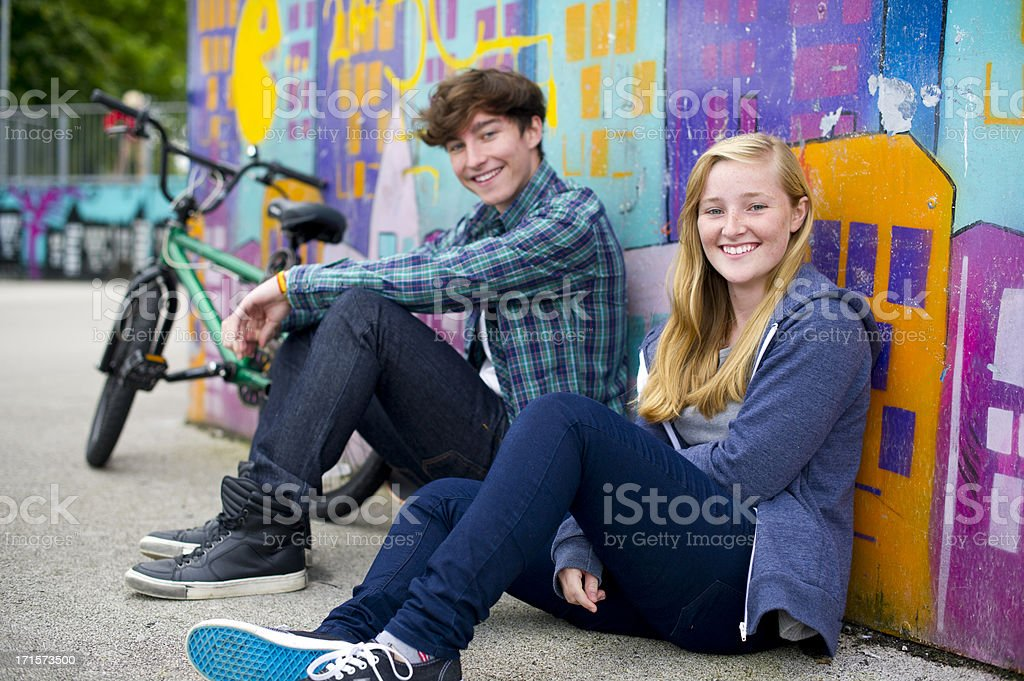 teen couple at the skatepark stock photo