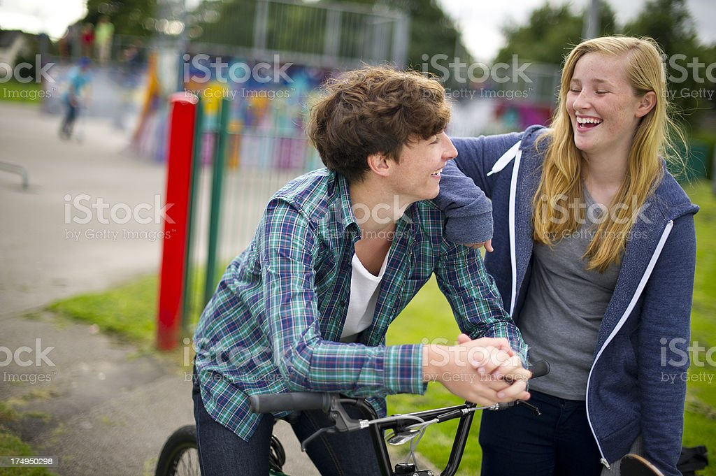 teen couple at the skatepark royalty-free stock photo