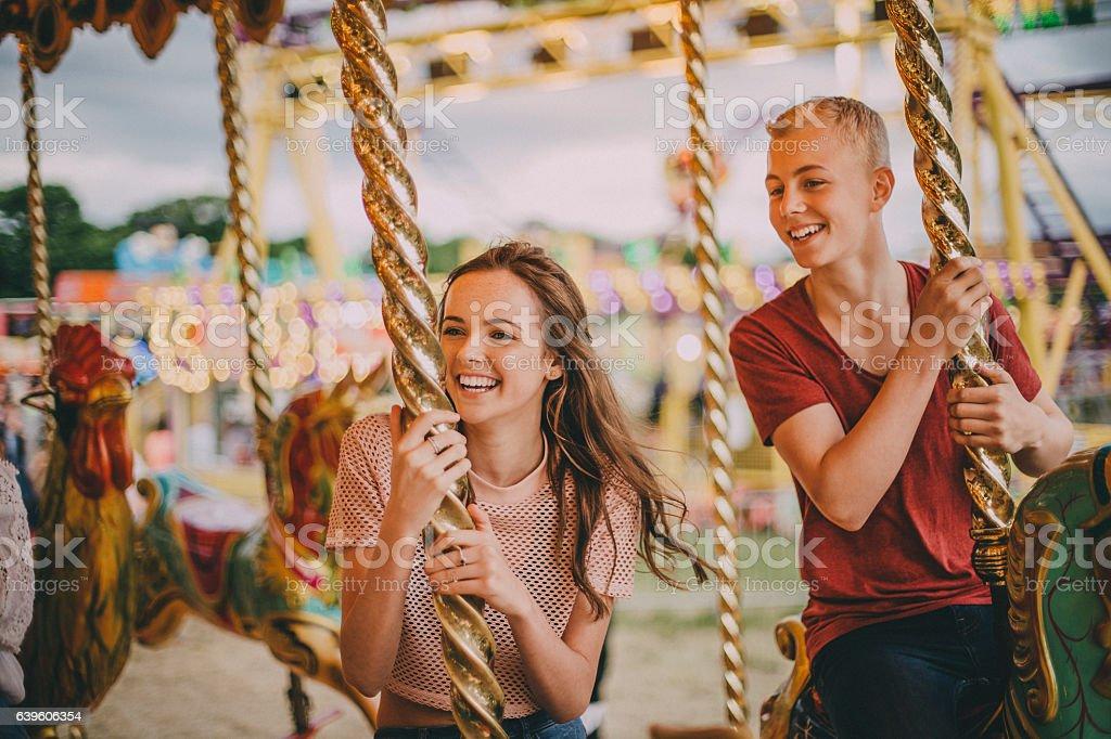 Teen Couple on Merry go round stock photo