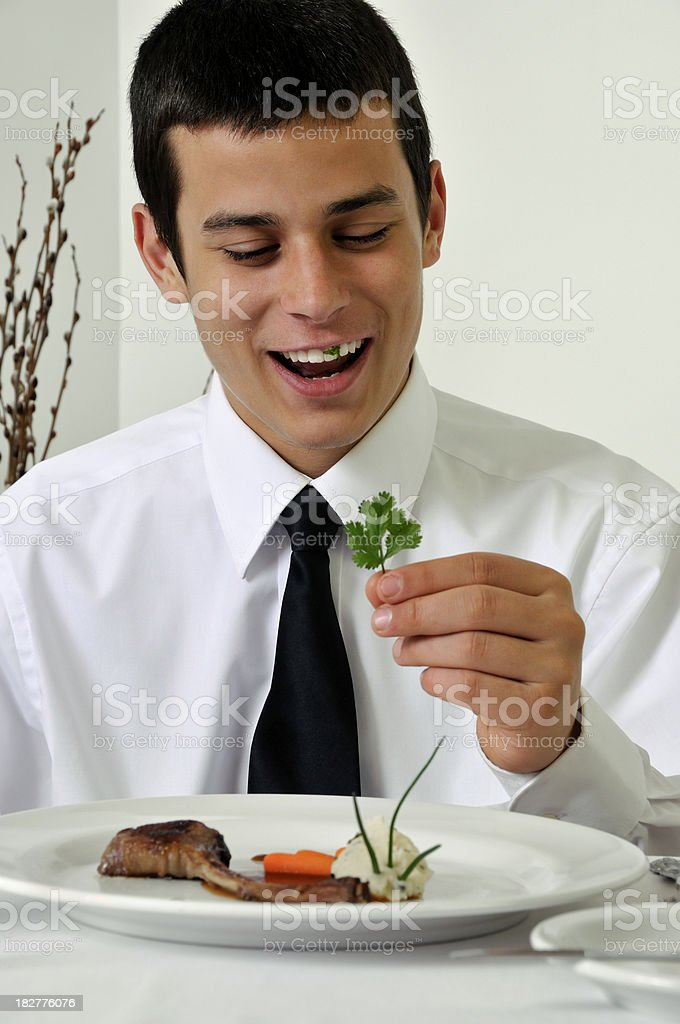 Teen Diner Eating the Garnish... Some Stuck in Teeth royalty-free stock photo