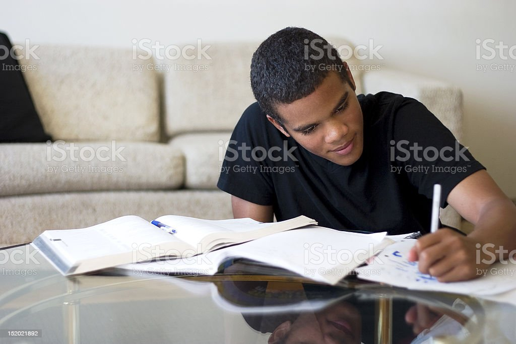 Teen Doing Homework stock photo