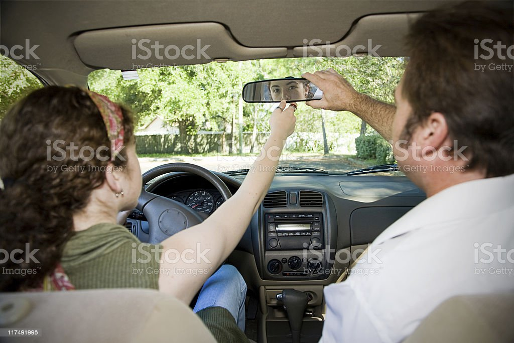 Teen Driver - Adjusting Mirror stock photo