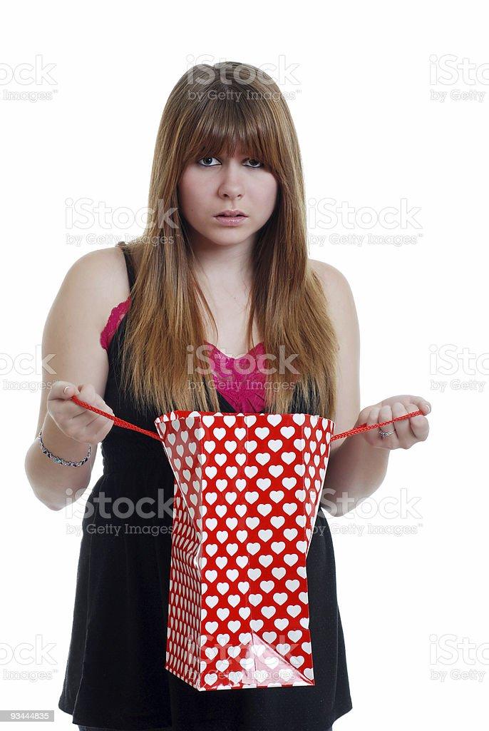 teen Frau schockiert am Valentinstag-Geschenk Lizenzfreies stock-foto
