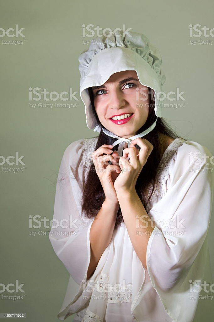 Teen Female Tying The Strings Of Her Bonnet stock photo