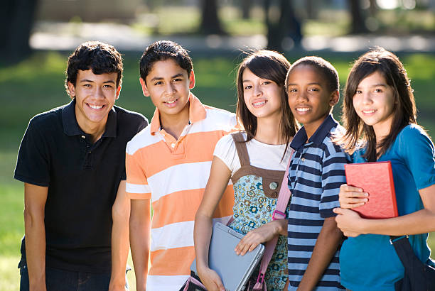 Teen friends preparing to study, facing camera Friends studying teenagers only stock pictures, royalty-free photos & images