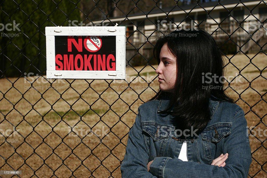Teen Girl and No Smoking Sign royalty-free stock photo