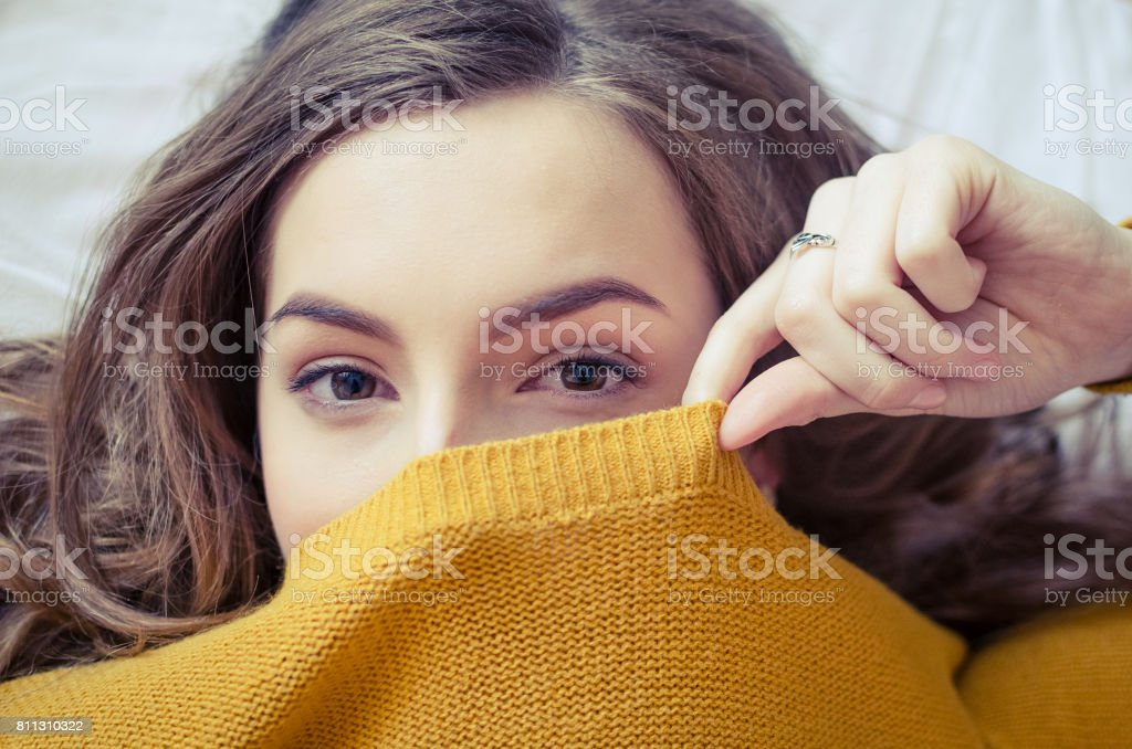 Teen girl covering her face - Royalty-free Above Stock Photo