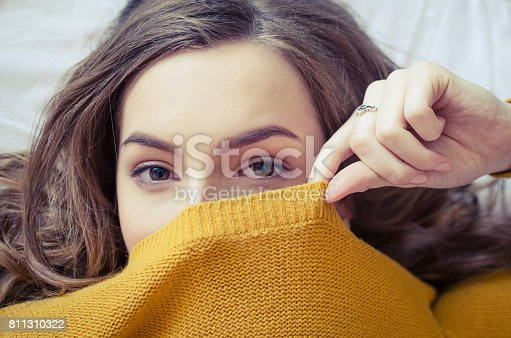 istock Teen girl covering her face 811310322